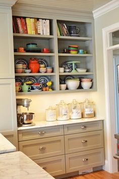 like the bakers station. room for mixing bowls, measuring tools, etc in drawers. Room for baking supplies and pans above.