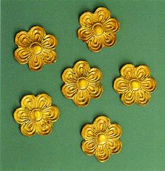 The Aidonia Treasure - Gold repousse cut-out ornaments in the form of a rosette with six petals. 15th century BC. Diam. 6 cm.