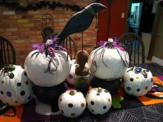 """Painting pumpkins!!   Fun for the whole fam!!   MY idea is to use purples, black & a neon green to paint your pumpkins.  Also using the """"guts"""" of the pumpkin to drape over a craved pumpkin gives the effect of brains spilling out.   SCARY!!!"""
