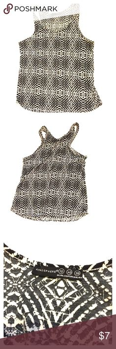 Tribal Patterned Cotton Racerback Tank This is a very flattering cut racerback tank in a fun pattern. It is cotton and very cool for spring and summer. This has only been worn a few times and is in good condition. It is a U.K. 12, so more of an 8/10. Tops Tank Tops