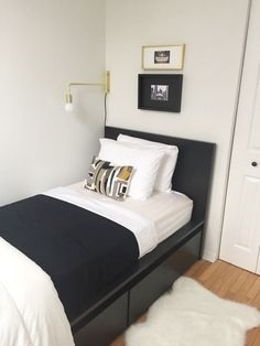 Affordable IKEA buys can look high-end when properly styled: this MALM bed looks incredibly chic, thanks to fitted bedding, modern lighting and a classic black, white and gold color scheme.