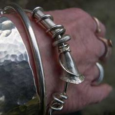 Handmade silver bangles http://www.silverandstone.co.uk/html/silver_expanding_bangle_b31.html