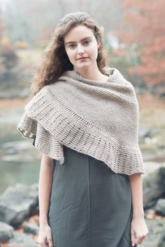 """Inspired by the song """"The Leading Bird"""" by Markéta Irglova, I designed this  cozy half-pi shawl with the idea of creating a wooly piece with a rustic,  yet graceful feel. Worked top down in Owl and featuring garter stitch and  dropped stitch techniques, Leading Bird is the perfect project to take with  you wherever you may go.  kills required : knitted cast on, increasing, decreasing, working with  dropped stitches.      * 52 """" wingspan, 20"""" depth     * 720 yds of Worsted weight yarn…"""