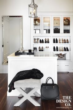 Chic walk-in closet features a glass and nickel lantern hanging over a closet island next to a gray velvet x-stool. Wardrobe Closet, Master Closet, Closet Space, Closet Doors, Closet Bench, Master Bedroom, Walk In Closet Inspiration, Closet Island, Built In Dresser