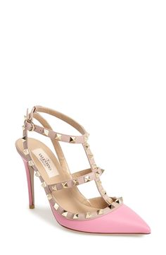 You can't go wrong with pink! Love these Valentino Rockstud leather t-strap pumps.