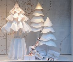 Paris Chanel Christmas store window—white trees—made from huge laser cut paper (to look/mimic paper doiles)❣