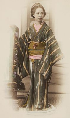 Hand-colored photo of young woman in kimono. Photographer possibly Felice Beato, late 1860's or 1870's, Japan.
