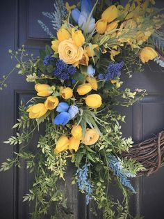Blue Yellow Spring Wreath, Spring Wreaths, Spring Door Wreaths, Yellow Blue Wreath, Tulip Wreaths, Door Decor Spring, Gift for Her, Wreaths What a gorgeous combination blue and yellow make! This wreath has mini tulips, boxwood and other greenery creating a flowing wreath fit for