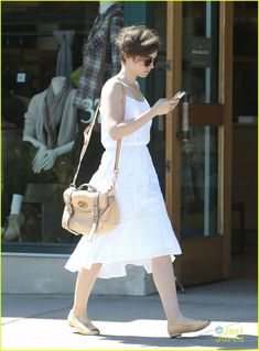 Lily Collins takes advantage of the warmer weather and wears a cute sundress while out in Los Angeles on Wednesday afternoon (March 25).