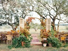 Fall-inspired ceremony site with a rug lined aisle