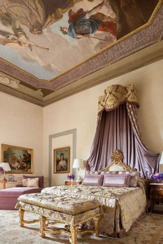 A bedroom with antique canopy bed at Four Seasons Hotel Firenze, in Florence, Italy