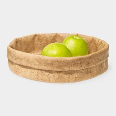 Adjust-A-Bowl Cork Bowl  Cork~Adjustable Bowl  Made from cork, a renewable resource that is naturally anti-microbial and water- and stain-resistant, this bowl is strong yet pliable. The rim of the bowl can be folded down to adjust its height. Versatile, this bowl can be used to serve bread or snacks, or as a container throughout the home or office. Made of natural cork harvested sustainably from the cork oak tree and latex, with a poly-cotton