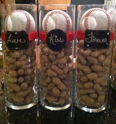 """this is concept for party room tables but no peanuts -- some tables would have all golf balls and some would have baseballs -- there would be 3 varying heights of cylinders (6"""", 9"""" and 12"""") with 1 16"""" pedestal in the middle -- all would have floating candles -- NO PEANUTS -- Chad's logo on cylinders"""