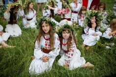 Girls attend a celebration on the traditional Ivana Kupala (Ivan the Bather) holiday, an ancient tradition originating from pagan times that is usually marked with grand overnight festivities during which people sing and dance around campfires, believing it will purge them of their sins and make them healthier, in Kiev, Ukraine, July 6, 2016. REUTERS/Gleb Garanich