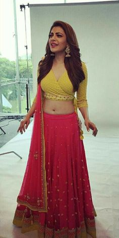 Kajal Agarwal Navel Photo Shoot In Red Lehenga Yellow Choli Stylish Blouse Design, Fancy Blouse Designs, Blouse Neck Designs, Indian Blouse Designs, Blouse Styles, Lehenga Designs, Choli Designs, Red Lehenga, Anarkali