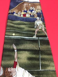 Tennis anyone? Men's silk necktie showing a tennis match. 58 inches long.  Made in USA by Surrey.