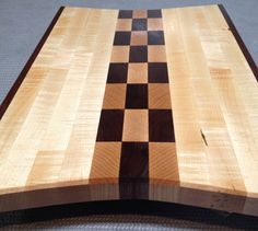 Curly maple and black walnut cutting board by HartmanWoodworks