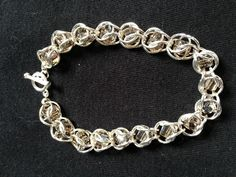 Silver chain maille with square smokey crystal beads.