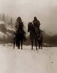 A beautiful picture of Native Americans in Winter. It was created in 1908 by Edward S. The picture presents Two Crow (Apsaroke) Indian men. One is horseback. The ground is covered with snow, and trees and hillside are seen in the background. Native American Beauty, Native American Photos, Native American History, Native American Indians, Cherokee, Crow Indians, Trail Of Tears, Le Far West, Native Indian