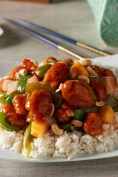 David Venable QVC's Sweet & Sour Chicken -1lb frozen breaded popcorn chicken -2Tbsp oil -1tsp fresh ginger, grated -1c onion, chopped -1c celery, sliced thin on the bias -1c green pepper, chopped -1c canned pineapple chunks -1/2c juice from canned pineapple -1/2c rice wine vinegar -2/3c ketchup -1Tbsp cooking sherry -1/2c dry roasted cashews, chopped -2c long grain rice, cooked