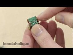 http://www.beadaholique.com/yt - In this video, learn how to use a Tierra Cast ribbon slide end to finish off a length of peyote stitch bead weaving so that you can attach a clasp.    Designer: Megan Milliken    You can find the supplies in this video at Beadaholique.com:    TierraCast  http://www.beadaholique.com/t-hb-tierracast.aspx#gsc.tab=0.
