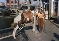 Cowgirl paying to park, 1939