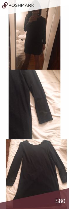 COS dark grey dress with black leather trim sz M COS dark grey dress with black leather trim sz M. Material is a stretchy cotton viscose blend that is machine washable and the trim on thee sleeves is real leather. Worn a few times and washed. Great understated classy look. cos Dresses Long Sleeve