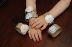 """How fun!  """"Watches"""" made from toilet paper tubes.  These would be great for practicing telling time--maybe a matching game? katiebam  How fun!  """"Watches"""" made from toilet paper tubes.  These would be great for practicing telling time--maybe a matching game?  How fun!  """"Watches"""" made from toilet paper tubes.  These would be great for practicing telling time--maybe a matching game?"""