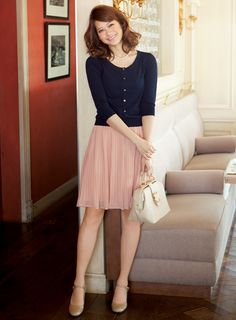 Spring/Autumn- Pleated skirt, neutral heels, buttoned-up cardigan