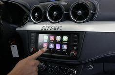CarPlay — Apple's operating system will be incorporated into more cars in 2015. CarPlay features the Siri voiceand assists drivers with directions, calls, messages and music streaming. Apple has partnered with multiple car companies including Audi, Jeep, Kia and Ford. CarPlay is also available for earlier models with an aftermarket system.