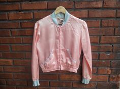 Satin jacket to wear to the roller rink. I had one of these!!!! for my 13th Birthday and it was hooded in Champagne color with baby blue satin pants