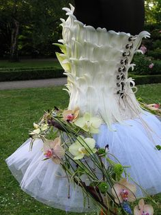 Flower Dress | The flowers would all wear this dress, but in different shades. The flowers draped over the skirt would also vary according to what flower each girl would be portraying. These dresses are bright, light, and fairy-like. They fit the flowers' optimistic personalities.