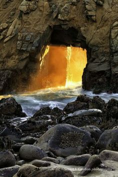 Golden Door, Big Sur . Along the beach at Pfeiffer State Park is this natural arch carved out by the sea in a magnificent rock formation. At the right time of year and time of day, a wonderful thing happens.,a golden shaft of light from the setting sun shoots through the arch creating a golden doorway© Stuart Gordon —