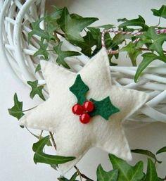a white star with mistletoe of felt