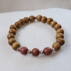 Bekijk dit items in mijn Etsy shop https://www.etsy.com/nl/listing/566534479/armband-houten-kralen-en-metaal-kralen