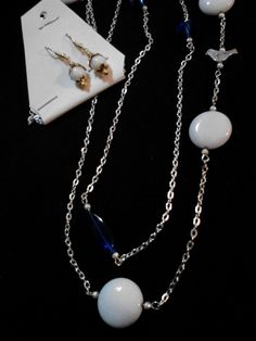 White and royal blue glass beads on this extra long necklace set