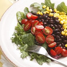 Here we top salad greens with black beans, sweet corn and grape tomatoes and bring it all together with a tangy avocado-lime dressing for a Mexican-inspired salad. Try this salad for a take-along lunch. To keep the salad greens from getting soggy, pack the greens, salad toppings and dressing in separate containers and toss them together just before eating.