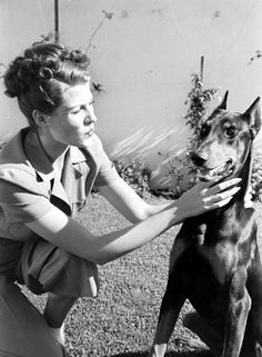 Rita Hayworth & Doberman Pinscher pal  Who would have thought I have something in common with Rita Hayworth?
