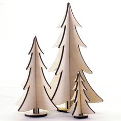 This decoration is free-standing wooden tree made up of 3 pieces of 3mm birch plywood.  The tree will be supplied as a natural finish, however