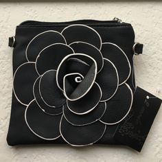 "Flower Cross Body Bag. Popular black square flower cross body bag.                              Dimensions:6.5"" ; 6.5"" 2 moda Bags Crossbody Bags"