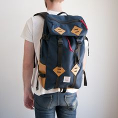 Topo Designs Klettersack 15L Backpack (navy) $140.00 Manufacturer: topo designs Condition: new  http://www.reqwip.com/product/55259523ac0e691100b31949/ Description: Topo Designs Klettersack 15L Backpack - 915cu in  1000D Cordura fabric Top entry with inner drawstring closure Adjustable shoulder straps 1 zippered top, 2 side pockets 1 internal laptop/hydration bladder sleeve Made in USA
