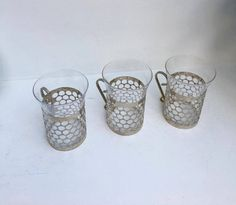 Set 3 cups, tea or coffee, glass and aluminum, modernist.  Very light glass, very fine, not heavy metal.  Possible to remove the metal to clean glasses in washes dishes.  7 cms D x 10 cms H.  Perfect vintage conditions   Shop this product here: http://spreesy.com/VintagechicBrussels/113   Shop all of our products at http://spreesy.com/VintagechicBrussels      Pinterest selling powered by Spreesy.com