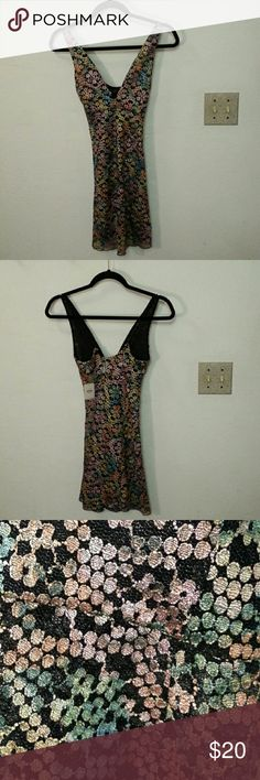 Intimately  by Free People metallic lace slip Really cute slightly  stretchy slip. Adjustable  black spaghetti  straps .  Great for an under or over layer. Tops Tunics