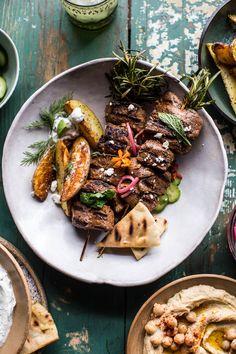 Greek Lamb Souvlaki Plates- grilled lamb, roasted potatoes & avocado tzatziki - super simple, so delicious and everyone will love! From halfbakedharvest.com