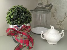 boxwood ball with christmas plaid ribbon in a laundry room Elegant Christmas Decor, Simple Christmas, Christmas Decorations, Plaid Christmas, Party Planning, Laundry Room, Ribbon, Interior Design, Easy