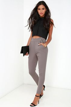 The All About That Sass Taupe Trouser Pants have all the right assets in all the right places! Lightweight poly fabric constructs relaxed-fit pant legs that fall from a high waistband accented with exposed gunmetal zippers. A pleated front with diagonal pockets, and decorative welted back pockets, top off these classic trousers that can go from nine to five, to a night on the town! Hidden zip fly and button closure.
