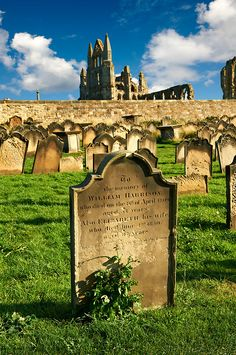 Cemetery headstone with Whitby Abbey behind, Whitby, North Yorkshire, England. There is a hostel right over that wall, we stayed in Jan. 2005. Part of Dracula is set in this cemetery.