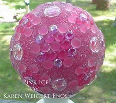 Garden balls tutorial showing how to make garden art balls with bowling balls or lamp globes and flat marbles.