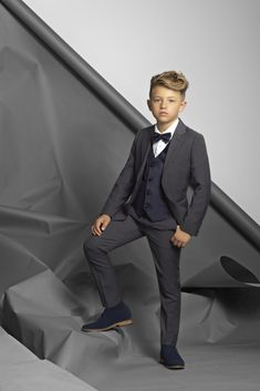 An example of impeccable tailoring; the Ruben five-piece suit has everything he is looking for in a formal wear outfit. Crafted in classic grey, with all the signature details of Paisley of London's premium range, Ruben is an impressive choice. Kids Wedding Suits, Wedding Outfit For Boys, Wedding With Kids, Wedding Attire, Charcoal Wedding, Charcoal Suit, Kids Suits, Little Boy Fashion, Little Boys