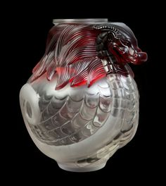 A Lalique Molded and Frosted Glass Vase | Height 14 inches.